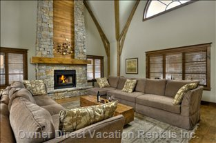 The Great Room Features a 23-foot Post and Beam Ceiling, Stone Wood Burning Fireplace and Comfortable Seating for 12.