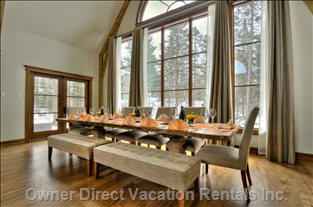 Dining Room, Adjoining from the Great Room, Features a Grand 12-foot Table which Seats 12+ with a View into the Great Outdoors.