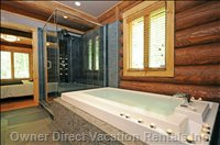 Master En Suite Bathroom - Infinity Edged Tub, Jetted Shower, Heated Floors, Double Vanity.