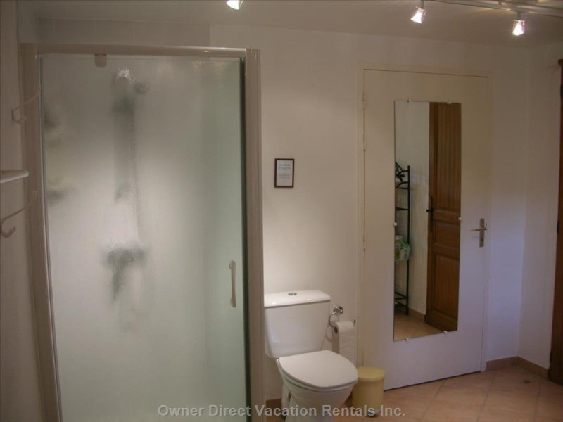 The Downstairs Bathroom with Washer and Drier