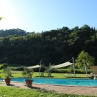 A Perfectly Maintained Swimming Pool Surrounded by Lush Greener and Views Towards Montone