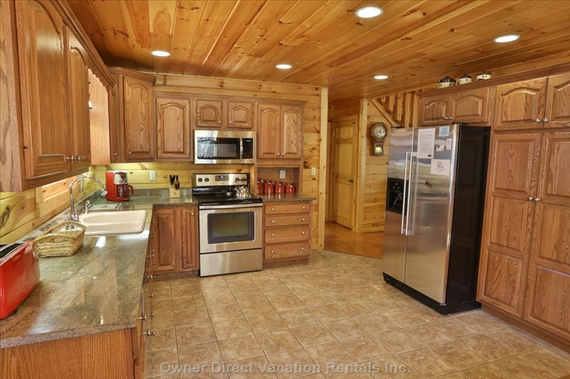 Spacious, Open Concept Kitchen with Stainless Steel Appliances