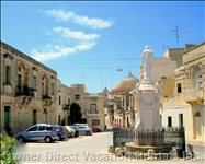 Piazza (House near Tree). Mosta Dome in Background