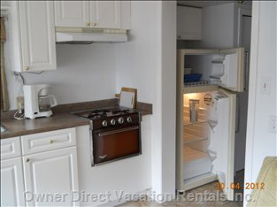 Full Size Fridge with Freezer in Kitchen Area.