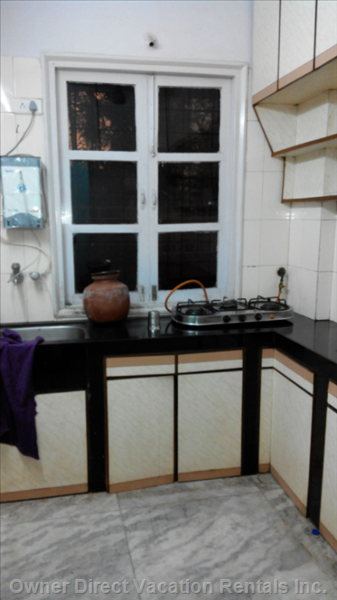 Kitchen with Granite Platform, Steel Sink and Tap, Marble Flooring, Tiled Walls, Cabinets, 3 Burner Piped Gas Connected Stove