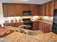 Kitchen with Granite Counters and Cherry Cabinets