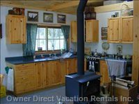 Kitchen Area W/ View of Open Woodland & Tree Fort