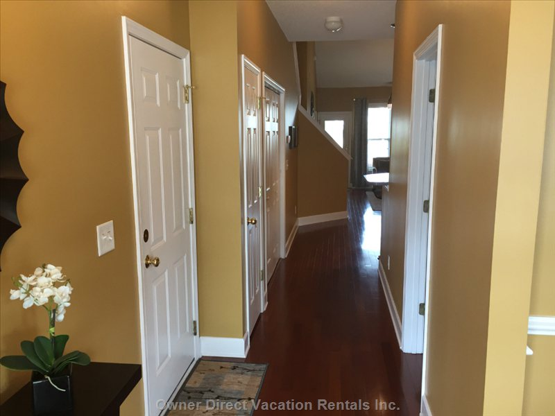 Inviting Entry. 1/2 Bath on Right; Garage Door, Closet and Laundry Area on Left