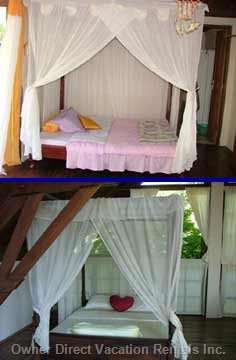 Two Queen-sized Beds - with Mosquito Nets