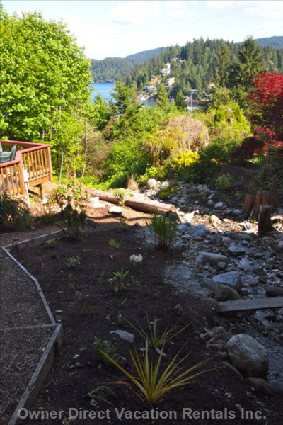 You Can a View of the Cove from the Outdoor Hot Tub and Deck in the Garden with the Running Stream