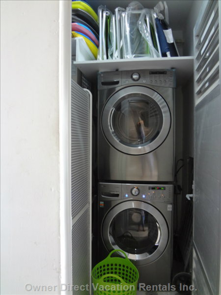 Private Laundry Room (Belongs to our Unit) - both the Washer and Dryer Have Extra Features to Include Steam-cleaning Option.  Here in our Laundry Room we Have 7 Boogie Boards, 6 Folding Beach Chairs, Folding Shopping Cart for Quick Trips to Mega and Piks Club (20-min Walk Away), and Step Stool.
