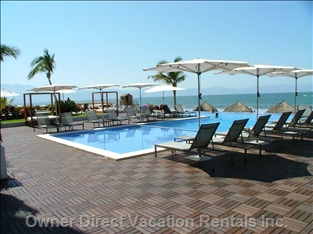 Pool Patio Area - Includes Four Sun Beds, Six Palapas, and Lounges and Umbrellas