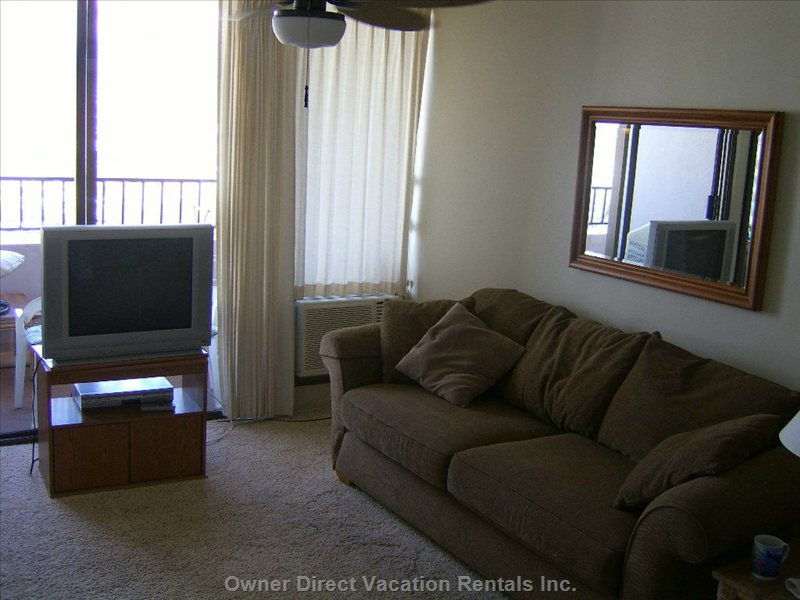 Living Space - Queen Sized Couch Divan.  T.v. is on a Swivel Deck.  Comfortable Leather Recline/Rocker.