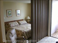 Bedroom - King Sized Bed with Sliding Privacy Wall.