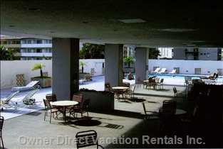 7th Floor Pool - the 7th Floor is 1/4 Recreation Deck. Including:  Pool, Covered Relaxation, Tennis Court, Bbq and Tables, Modest Cardio Gym, Very Modest Childrens Area, and Coin Operated Laundry Area.