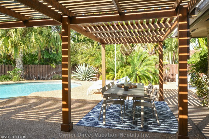Large Pergolas Covering Outdoor Dining and Outdoor Lighting for Evening Entertainment.