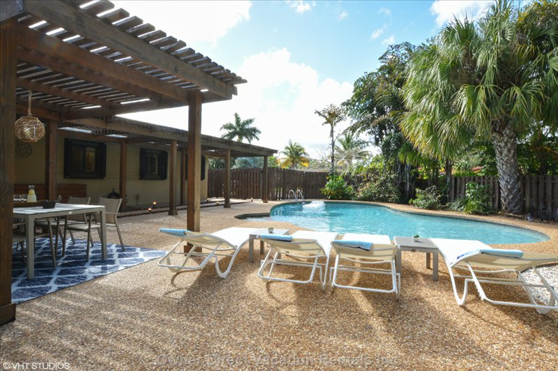 Outdoor Deck Includes 6 Lounge Chairs, 2 Sofas, Led Umbrella and Outdoor Dining for 6 People.