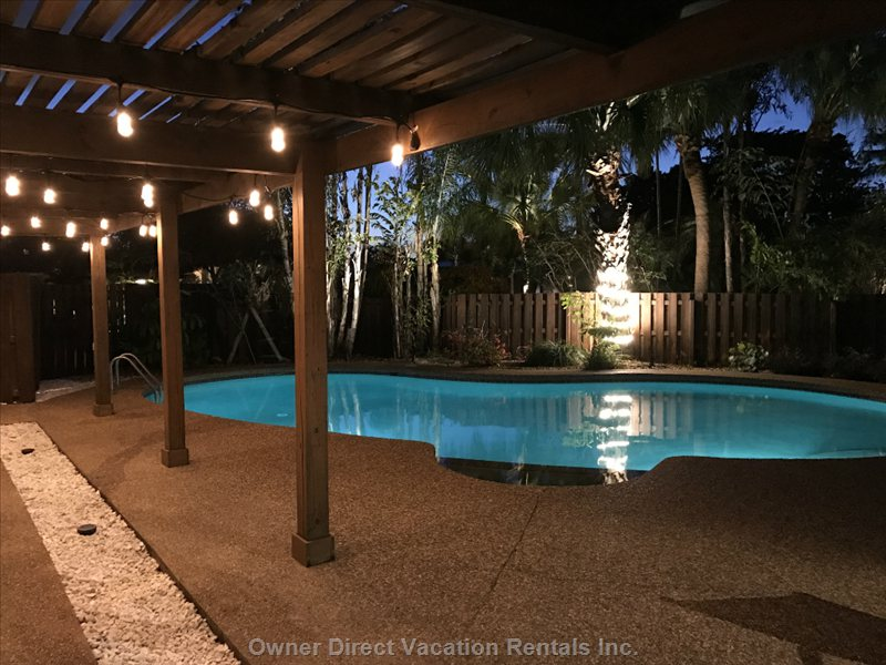 Pergola Lights and Wrapped Palm Trees and Upcast Lighting for a Second to none Evening Experience.