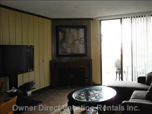 Large Flatscreen, DVD, Fireplace, and Cozy Balcony.