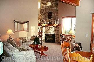 Main Living Area Including Stone Floor to Ceiling Fireplace