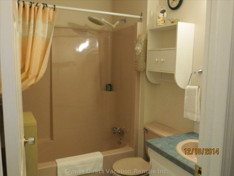 Full Bathroom with Combined Tub and Shower.