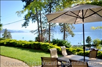 Private Patio and Steps to the Beach (1 Minute Walk) - Private Patio with Kelowna Bridge South (Left) and West Sunsets for your Evening Pleasure