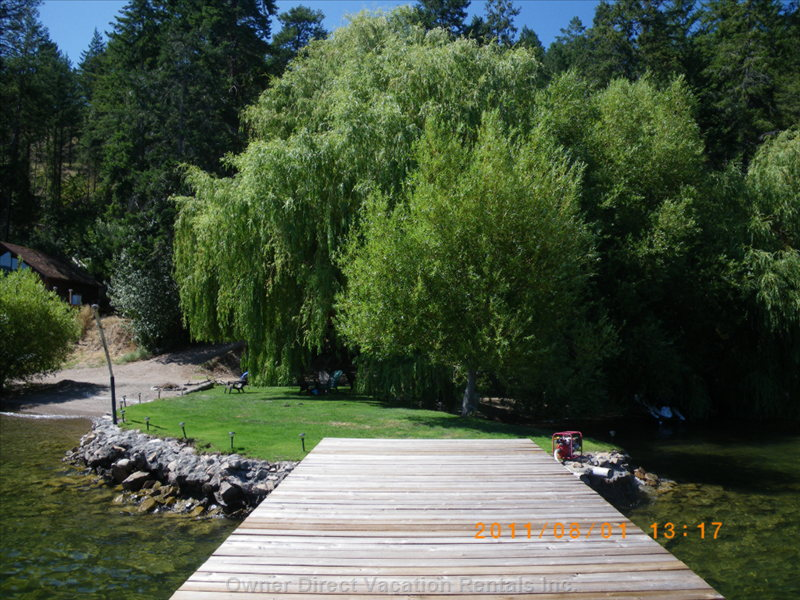 View from the Dock Toward the Beach Jetty. House is Hidden behind the Large Weeping Willow Trees.