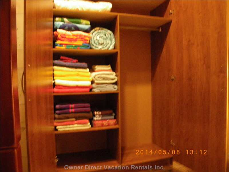 Wardrobe for Hanging your Clothing. Generous Supply of Beach and Bath Towels that Can be Moved to Bathroom Cabinets for Extra Storage.