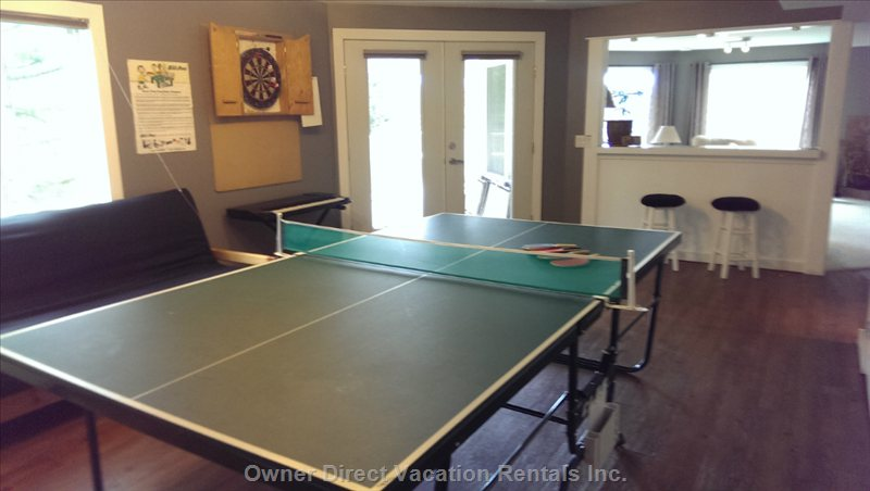 The Fun Room, Ping Pong and Darts.  French Doors to the Lower Deck and Backyard.