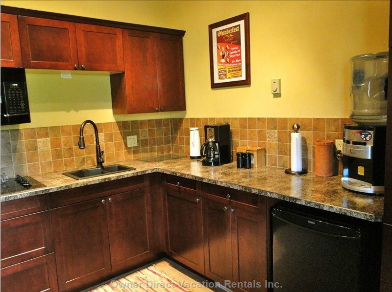 Fully Equipped Modern Kitchen, Shared between the Two Suites.