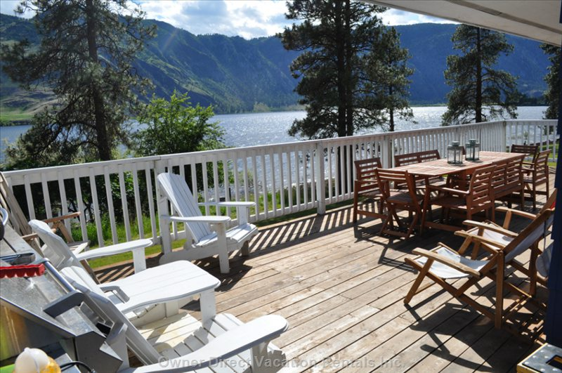 Spacious Deck with Ample Seating and Gorgeous Views of the Lake and Surrounding Mountains.