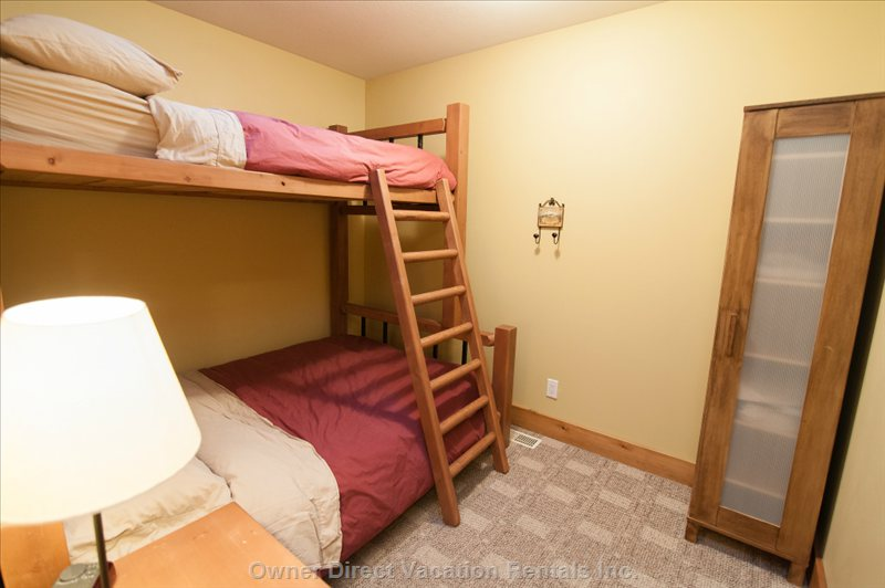 Second (Middle Bedroom) - Double Sized Bed on Bottom Bunk Level; Twin on Top Level.  Room has a Skylight with Blind.