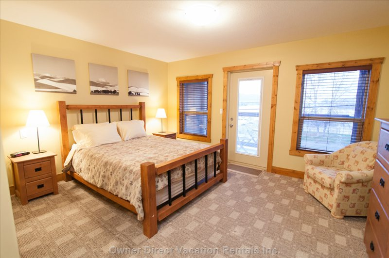Master Bedroom (Queen Sized Bed) & Two Tub Chairs with Access to Balcony Area.
