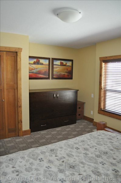 Third Bedroom with View of the Cabinet Bed in Closed Position.  Large Storage Drawer for Bedding.