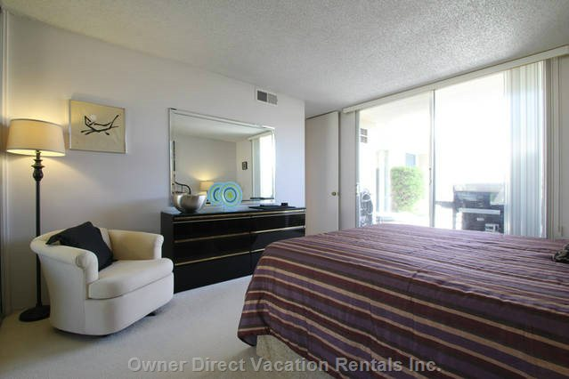 Spacious Guest Bedroom with Queen Size Bed and Easy Access to Second Bathroom and Patio