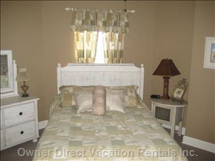 Third Bedroom - Queen Size Bed, TV/DVD, Alarm Clock, Two Lamps, Private Bathroom.  Elegantly Furnished.