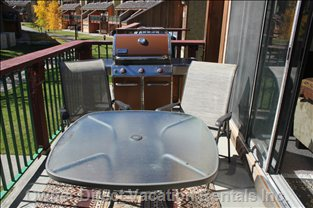 Outside Deck with Bbq and Table with Four Chairs