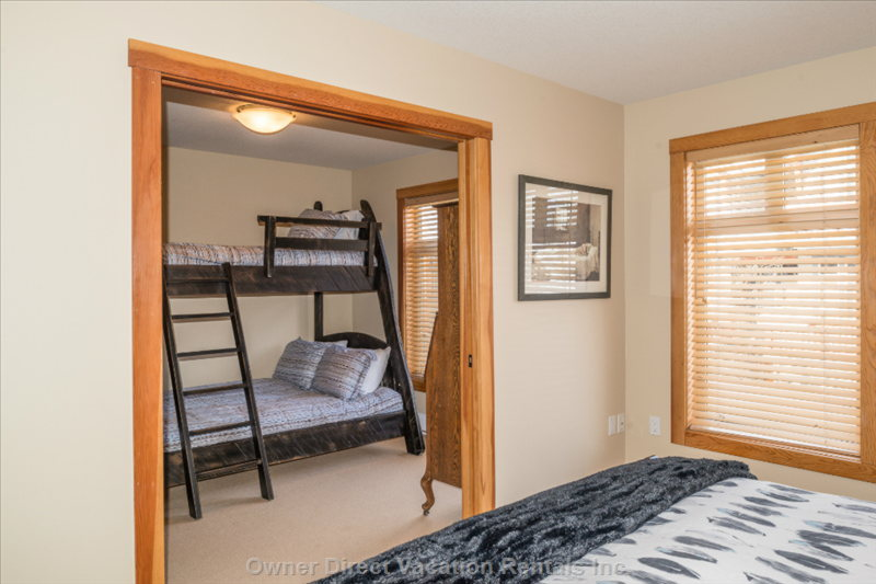 Bedroom 2 and 3 are Divided by Solid Wood Pocket Doors.