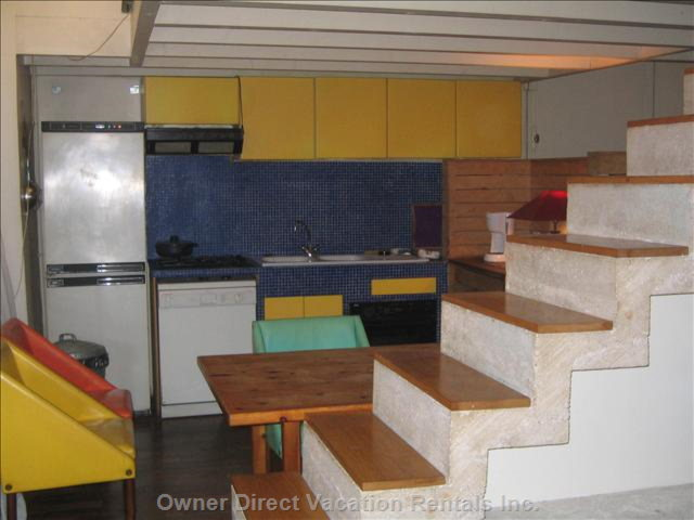 Kitchen and Staircase to Room 1 and 2