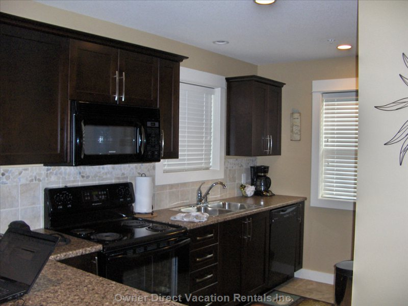 Modernly Equipped Kitchen Affixed with all the Amenities of Home - Includes  a  Dining Bar