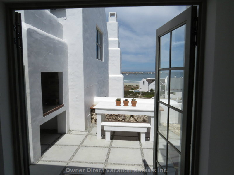 From Kitchen: Braai & Patio, Beach & Sea Views beyond; Steps Right down to Gate