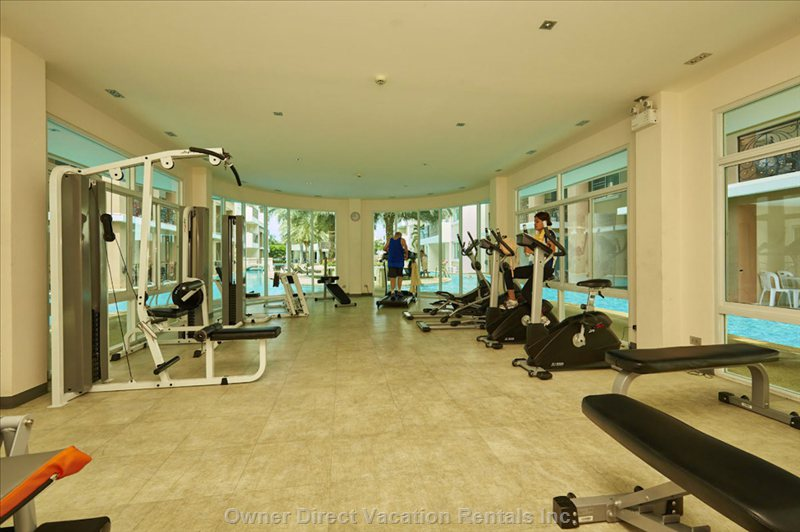 Fully Equipped Gym with Views of the Pool