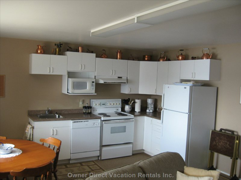 Kitchen is Fully Equipped with Dishwasher, Dishes, Pans Etc.