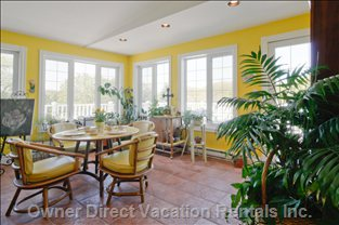Breakfast Room - South and West Facing Windows Create a Cheerful Play of Sunlight, Bringing the Outdoors Inside.