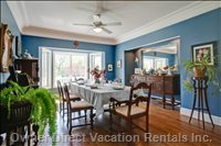 Dining Room - Inviting Charm:  one Could Linger from Breakfast Thru Lunch.  View the Lawns through the Bay Window in this Elegant and Spacious Dining Room Where you Can Entertain in Uncrowded Comfort.