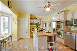 Kitchen - this Spacious and Inviting Kitchen has a Wealth of Counterspace, and Large Island, all Overlooking the Front Terrace and North Lawns.