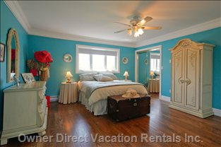 Master Bedroom - French Doors Open to the Tranquil and Private Sitting Room Adjacent the Master Suite.