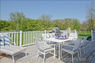Rear Deck - Excellent Spot for Entertaining on Warm Summer Evenings.  Wrap around Deck Allows for Numerous Conversation Zones.  Deck Overlooks Rear Lawns,and the Properties Own Orchard and Valley.