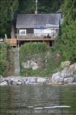 View from the Water - a Deer Grazes on the Beach in Front of the Cottage.
