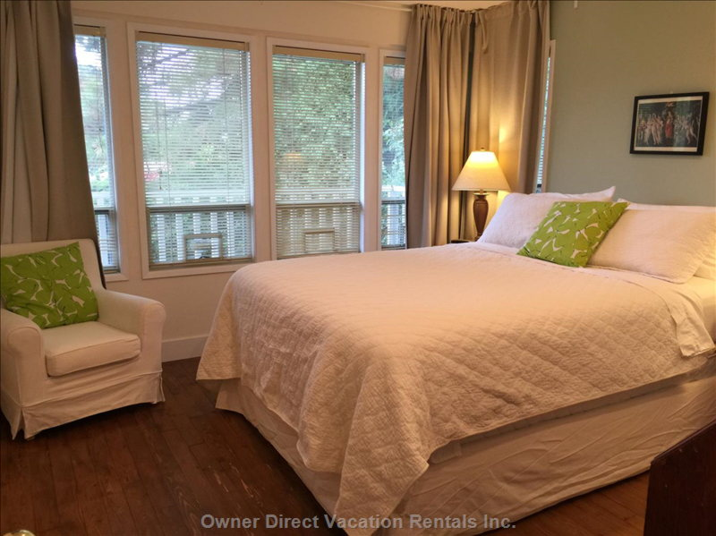 Queen Size Bedroom with 5 Windows Facing the Front Yard